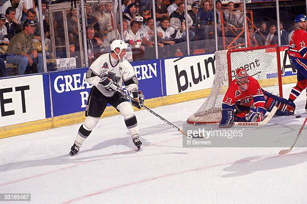 Canadian professional hockey player Patrick Roy goaltender for the Montreal Canadiens makes a save against Wayne Gretzky of the Los Angeles Kings as...