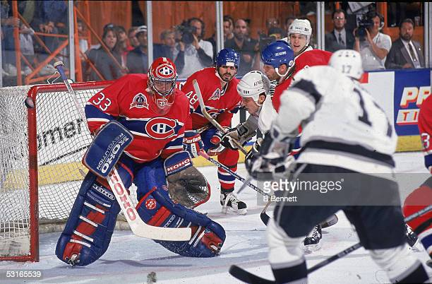 Canadian professional hockey player Patrick Roy , goaltender for the Montreal Canadiens, defends the net against Finn Jari Kurri and his teammates of...