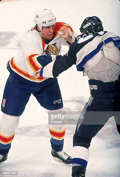 Canadian professional hockey player Paul Laus of the Florida Panthers fights compatriot Rudy Poeschek of the Tampa Bay Lightning 1995