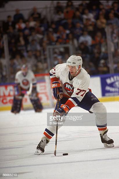 Canadian professional hockey player Pierre Turgeon, center for the New York Islanders, prepares to swing for the puck during a game at Nassau...