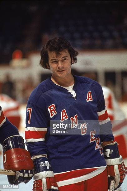 Canadian professional hockey player Rod Gilbert, right wing for the New York Rangers, smiles on the ice during a game, 1970s.