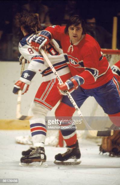 Canadian professional hockey player Serge Savard of the Montreal Canadiens battles for position with an unidentified opponent during a road game...