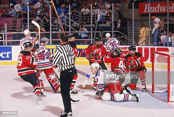 Canadian professional hockey player Stephane Richer left wing for the New Jersey Devils celebrates double overtime in front of the goal during Game 1...