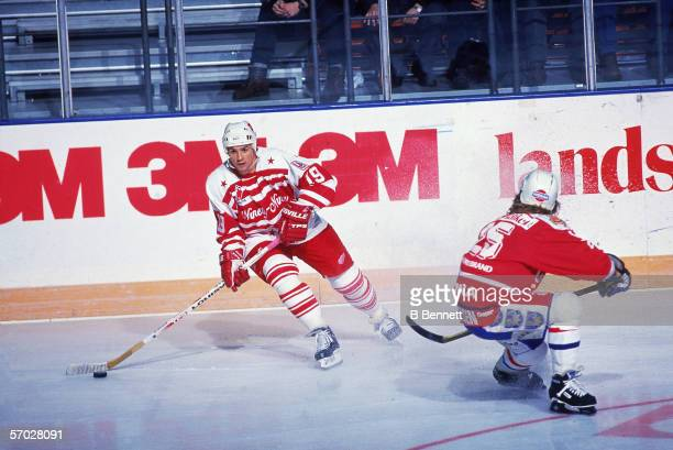 Canadian professional hockey player Steve Yzerman center for the Detroit Red Wings follows the puck during a game of the NinetyNine All Stars Tour...