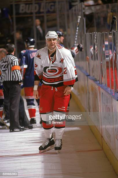 Canadian professional hockey player Stu Grimson of the Carolina Hurricanes stands on the ice and looks exhausted after a fight during a game with the...