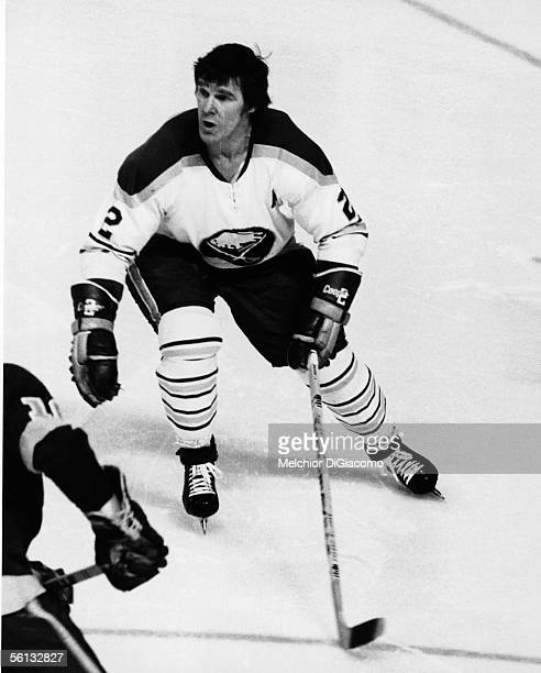 Canadian professional hockey player Tim Horton of the Buffalo Sabres skates during a game, mid 1970s.