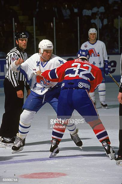 Canadian professional hockey player Tony Twist of the Quebec Nordiques fights Mario Roberge of the Montreal Canadiens Colisee de Quebec 199293 Season
