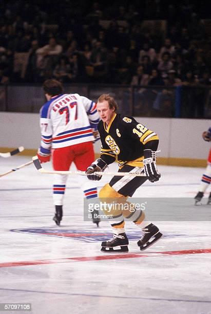 Canadian professional hockey player Wayne Cashman , right wing for the Boston Bruins, skates near Canadian professional hockey player Phil Esposito,...