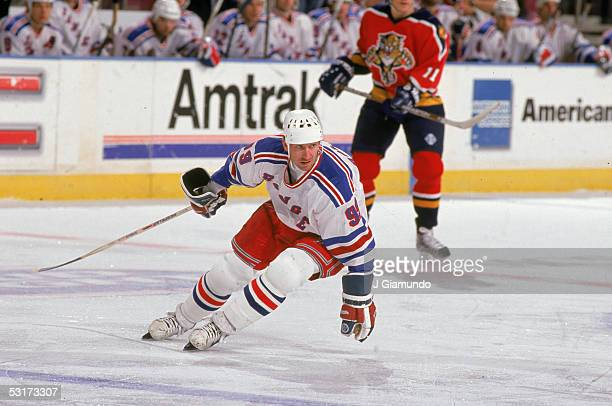 Canadian professional hockey player Wayne Gretzky forward of the New York Rangers on skates up the ice during a game against the Florida Panthers at...