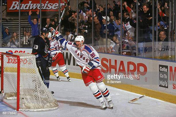 Canadian professional hockey player Wayne Gretzky, forward of the New York Rangers, celebrates a goal during a game against the Vancouver Canucks at...