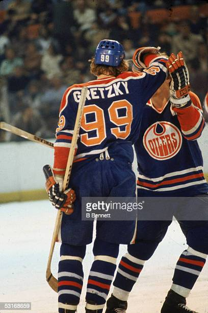Canadian professional hockey player Wayne Gretzky forward of the Edmonton Oilers celebrates with a teammate during the 197879 season