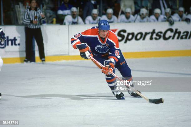 Canadian professional hockey player Wayne Gretzky, forward of the Edmonton Oilers, skates on the ice during a road game against the Hartford Whalers,...