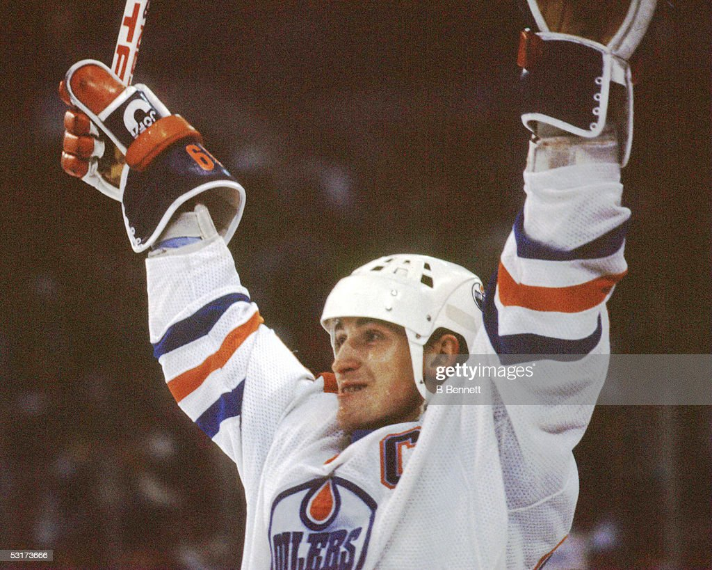 Canadian professional hockey player Wayne Gretzky, forward of the Edmonton Oilers, celebrates on the ice, 1980s.