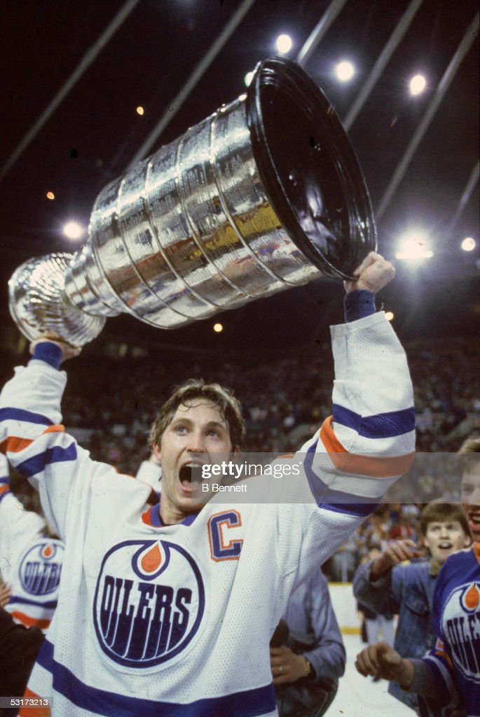 Since the 1930's the winners of the Cup have hoisted it above their heads and skated it around the rink. The Great One raised it four times with the Edmonton Oilers