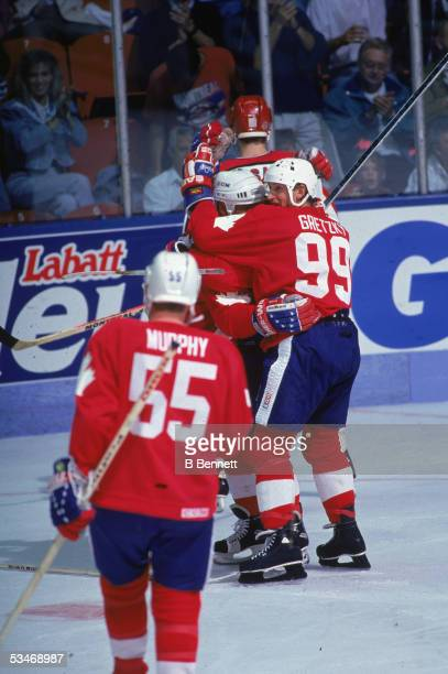 Canadian professional hockey player Wayne Gretzky the captain of Team Canada celebrates with a teammate during game one of finals against Team USA in...