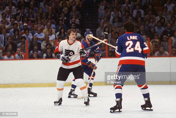 Canadian professional hockey players Billy Barber of the Philadelphia Flyers and Gordie Lane of the New York Islanders battle it out with hockey...