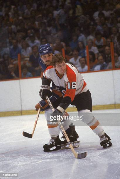 Canadian professional hockey players Bryan Trottier of the New York Islanders and Bobby Clarke of the Philadelphia Flyers battle for position during...