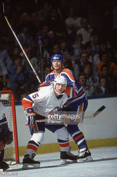 Canadian professional hockey players Denis Potvin , defenseman for the New York Islanders, and Mark Messier, center for the Edmonton Oilers, by the...