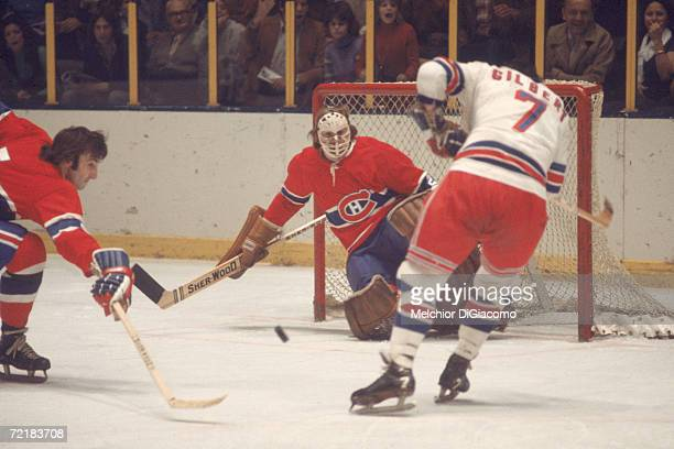 Canadian professional ice hockey player and later businessman, lawyer, author, and politician Ken Dryden, goalie of the Montreal Canadiens, defends...