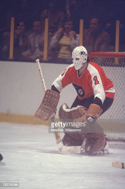 Canadian professional ice hockey player Bernie Parent goalie of the Philadelphia Flyers defends the goal during an away game late 1960s or 1970s...