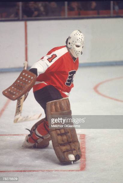 Canadian professional ice hockey player Bernie Parent, goalie of the Philadelphia Flyers, defends the goal during ana way game, late 1960s or 1970s....