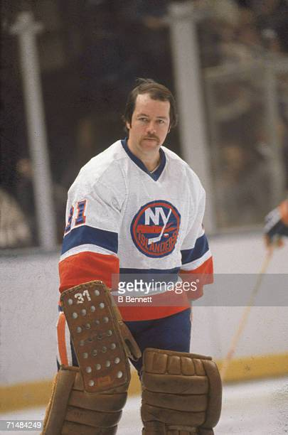 Canadian professional ice hockey player Billy Smith goalie of the New York Islanders on the ice without his mask during a home game Nassau Coliseum...
