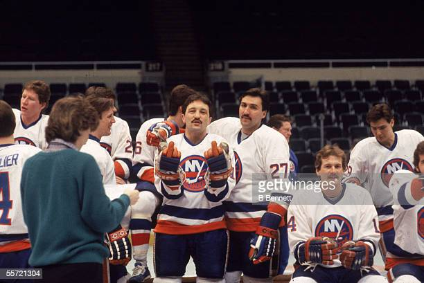 Canadian professional ice hockey player Bryan Trottier of the New York Islanders gives a double finger to photographer Bruce bennett during a team...