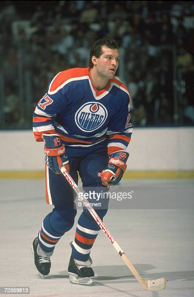 Canadian professional ice hockey player Dave Semenko of the Edmonton Oilers skates on the ice during a road game 1980s Semenko played for the Oilers...