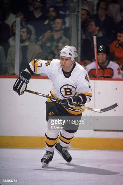 Canadian professional ice hockey player defenseman Ray Bourque of the Boston Bruins skates with his stick at hip level on the ice during a home game...