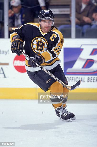Canadian professional ice hockey player defenseman Ray Bourque of the Boston Bruins skates with a stick on the ice during an away game circa 1998