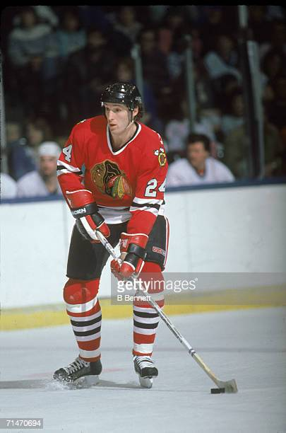 Canadian professional ice hockey player Doug Wilson of the Chicago Blackhawks skates with the puck on the ice during a road game against the New York...