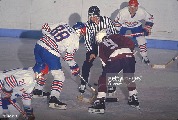 Canadian professional ice hockey player Eric Lindros of the Ontario Hockey League's Oshawa Generals faces off against Mike Ricci of the Peterborough...