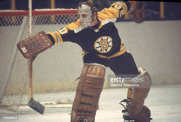 Canadian professional ice hockey player Gerry Cheevers, goalie of the Boston Bruins, makes a save on the ice during an away game, January 1979....