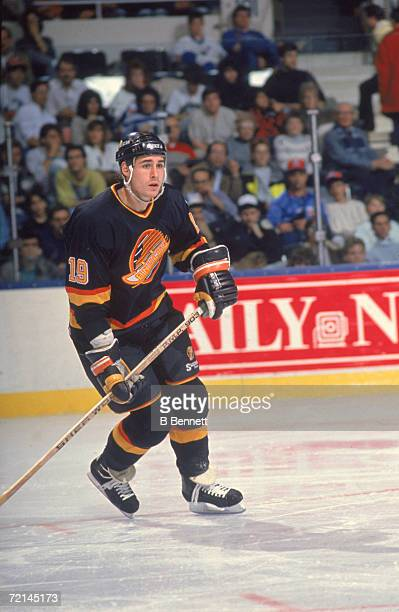 Canadian professional ice hockey player Jim Sandlak of the Vancouver Canucks skates on the ice during a game against the New York Islanders, Nassau...