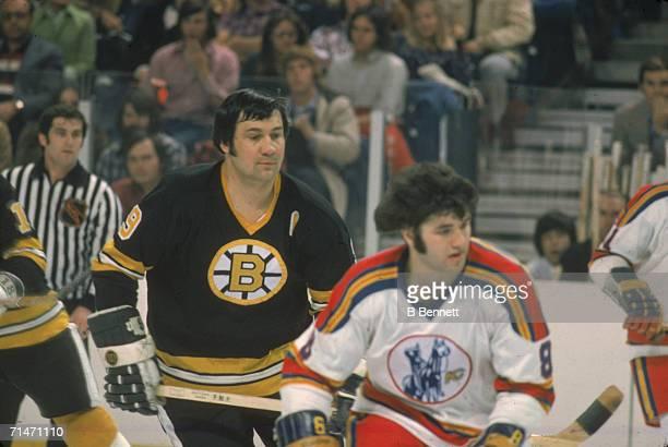 Canadian professional ice hockey player Johnny Bucyk of the Boston Bruins skates on the ice amid opposing Kansas City Scouts Kansas City Missouri...