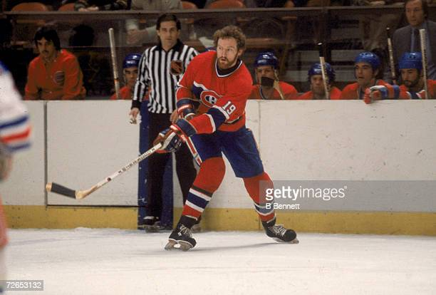 Canadian professional ice hockey player Larry Robinson of the Montreal Canadiens skates on the ice near a linesman during an away game, February...