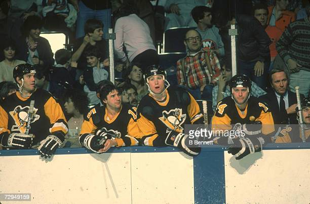 Canadian professional ice hockey player Marty McSorley of the Pittsburgh Penguins and teammates including Doug Shedden watch the action from the...