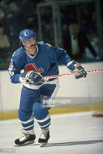 Canadian professional ice hockey player Michel Goulet of the Quebec Nordiques skates on the ice during a road game against the New York Islanders...