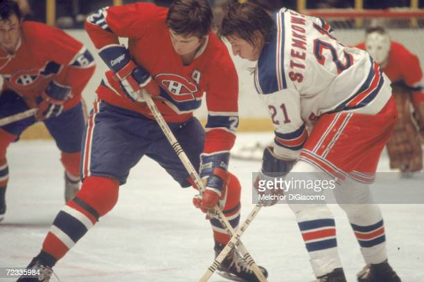 Canadian professional ice hockey player Pete Stemkowski of the New York Rangers battles Pete Mahovlich of the Montreal Canadiens on the ice during a...