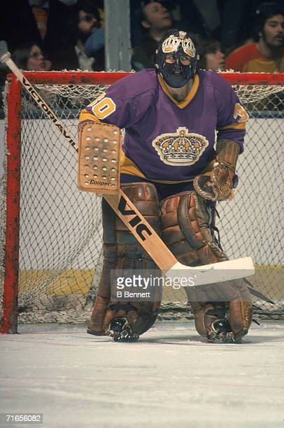Canadian professional ice hockey player Rogatien 'Rogie' Vachon, goalie of the Los Angeles Kings, guards the net on the ice during a road game,...