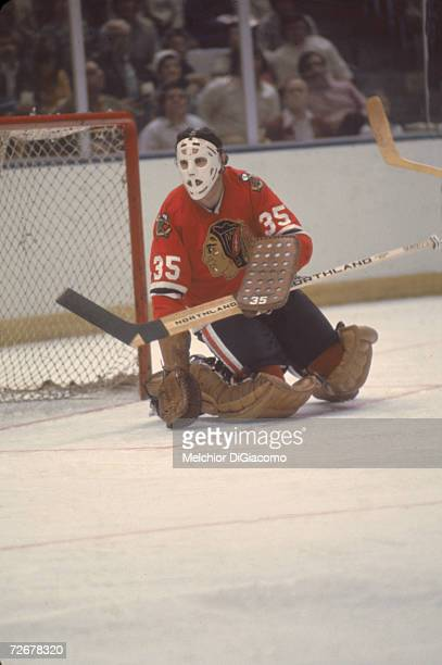 Canadian professional ice hockey player Tony Esposito goalkeeper for the Chicago Blackhawks guards the net during a game 1970s or early 1980s