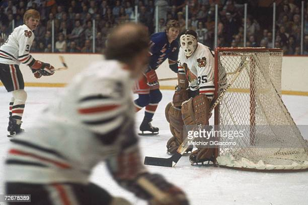 Canadian professional ice hockey player Tony Esposito goalkeeper for the Chicago Blackhawks guards the net during a game against the New York Rangers...