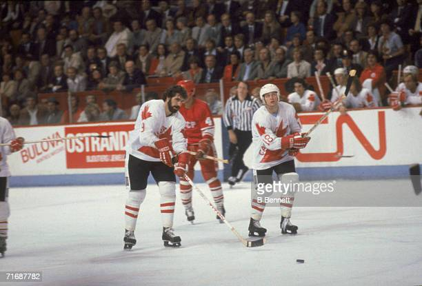 Canadian professional ice hockey players Clark Gillies and Danny Gare skate on the ice for Team Canada against the Soviet Union during the Canada Cup...