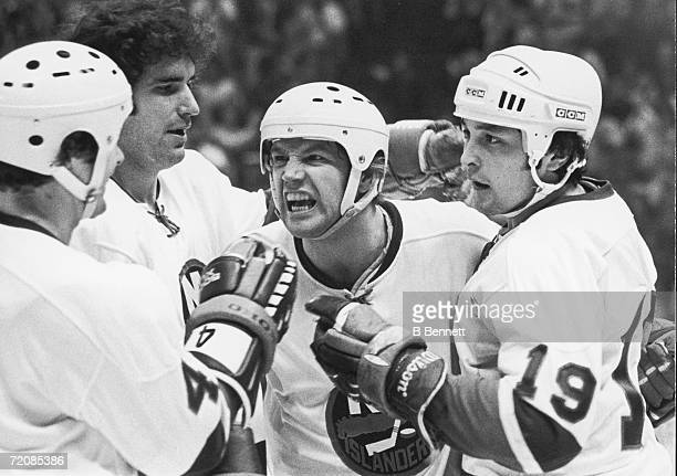 Canadian professional ice hockey players Jean Potvin Clark Gillies Denis Potvin and Bryan Trottier of the New York Islanders celebrate a goal Nassau...
