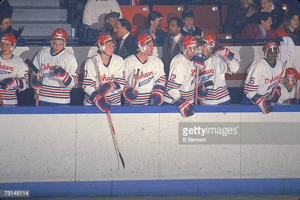 Canadian professional ice hockey players of the Ontario Hockey League's Oshawa Generals watch the action from the bench during a home game Oshawa...