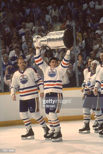 Canadian professional ice hockey players Randy Gregg and Geoff Courtnall of the Edmonton Oilers parade the Stanley Cup around the ice in celebration...