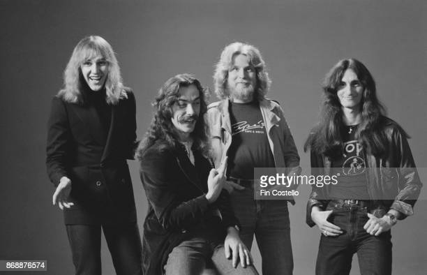 Canadian progressive rock group Rush 1978 From left to right guitarist Alex Lifeson drummer Neil Peart record producer Terry Brown and singer/bassist...