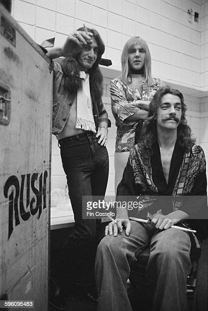 Canadian progressive rock group Rush backstage at the Civic Center in Springfield Massachusetts during the band's All The World's a Stage tour 9th...