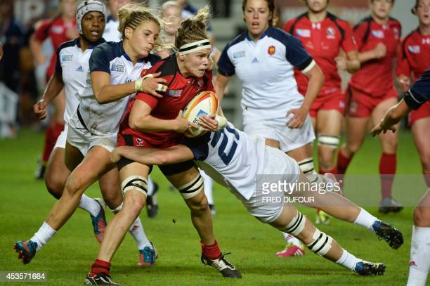 Canadian prop MariePier PinaultReid fights with France players during the IRB Women's Rugby World Cup semifinal match between France and Canada at...