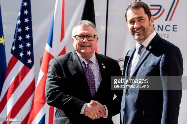 Canadian Public Safety Minister Ralph Goodale shakes hands with French Interior Minister Christophe Castaner at the Ministry of Interior Place...